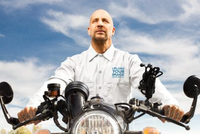 Mockup of a Man in a Button Shirt Riding His Motorcycle 31843