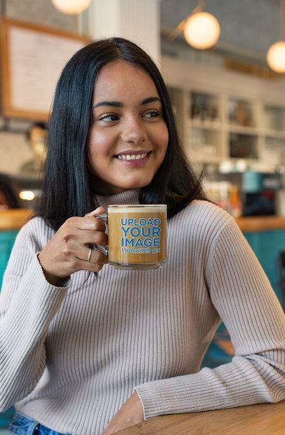 Mockup of a Smiling Woman Holding a Glass Mug 31734