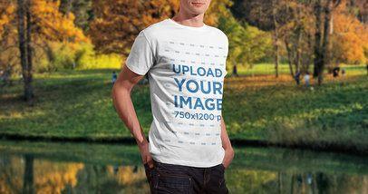 Mockup of a Man Wearing a T-Shirt Next to a Lagoon 2983-el1