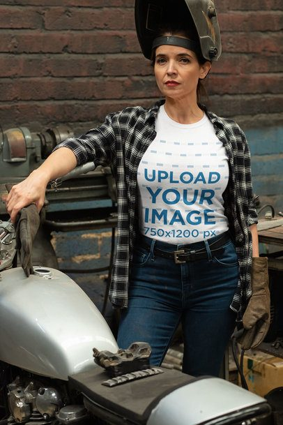 T-Shirt Mockup of a Woman Repairing Her Motorcycle 31798