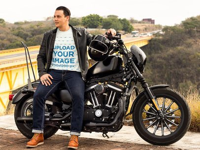 T-Shirt Mockup Featuring a Biker Standing Next to His Motorcycle 31856