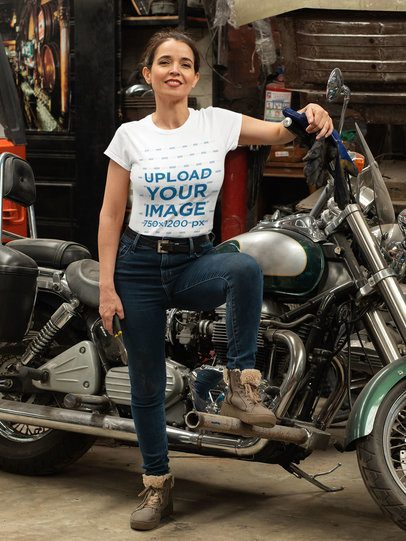 T-Shirt Mockup of a Biker Proudly Posing with Her Motorcycle 31796