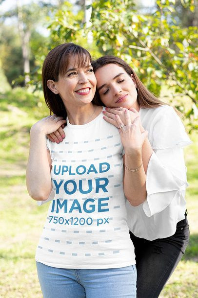 T-Shirt Mockup of a Woman Smiling While Her Daughter Hugs Her 32654