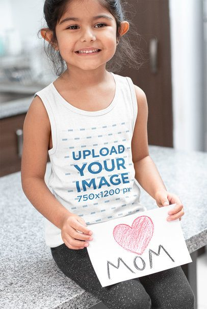 Tank Top Mockup of a Little Girl Holding a Mother's Day Drawing 32256
