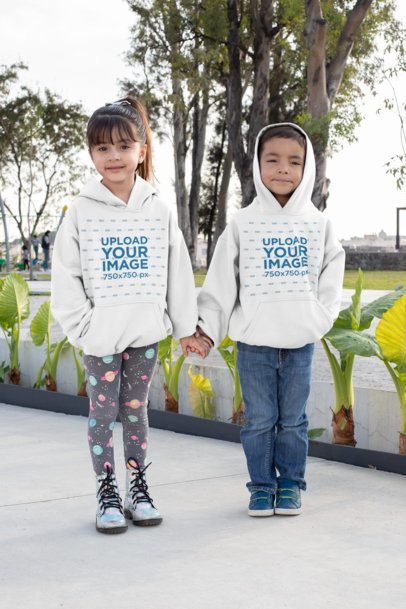 Hoodie Mockup Featuring a Boy and a Girl Holding Hands 31666