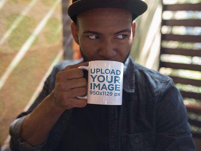 Mug Mockup of a Young Black Man Drinking a Hot Beverage a12294