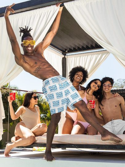 Swim Trunks Mockup Featuring a Man Having Fun with His Friends at a Pool Party 32674