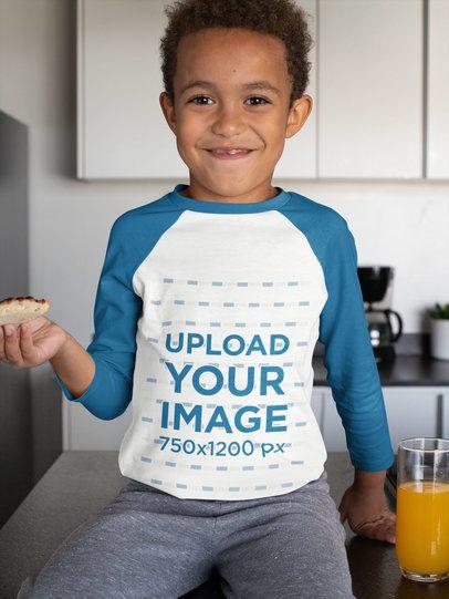 Mockup of a Boy Wearing a Raglan T-Shirt in the Kitchen 31647