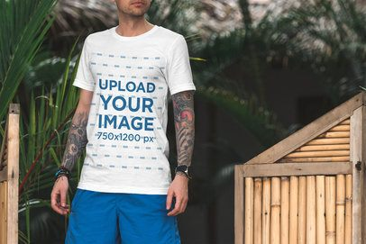 T-Shirt Mockup of a Tattooed Man on Vacation -el1