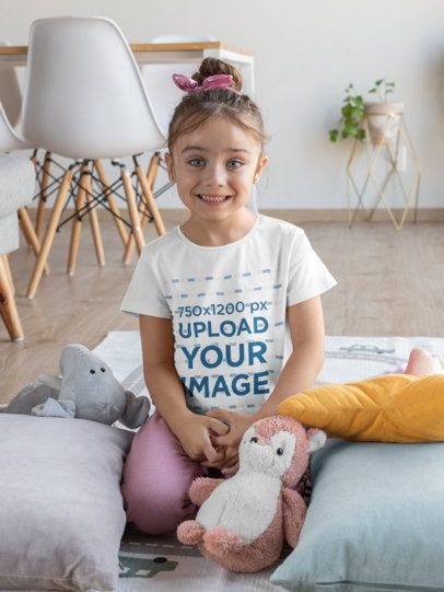 T-Shirt Mockup Featuring a Smiling Girl at Home 31686