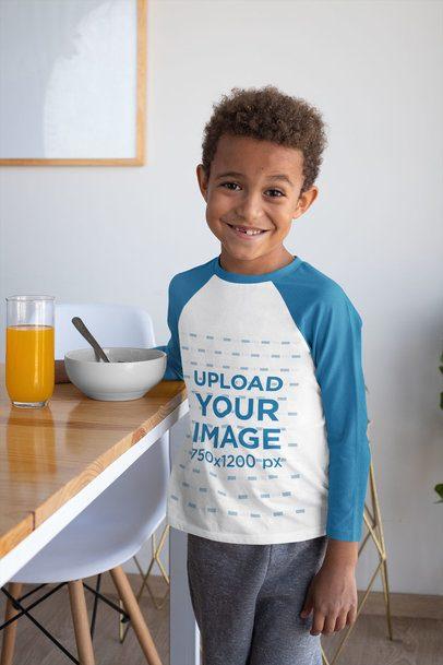 Raglan T-Shirt Mockup Featuring a Smiling Boy at Home 31643