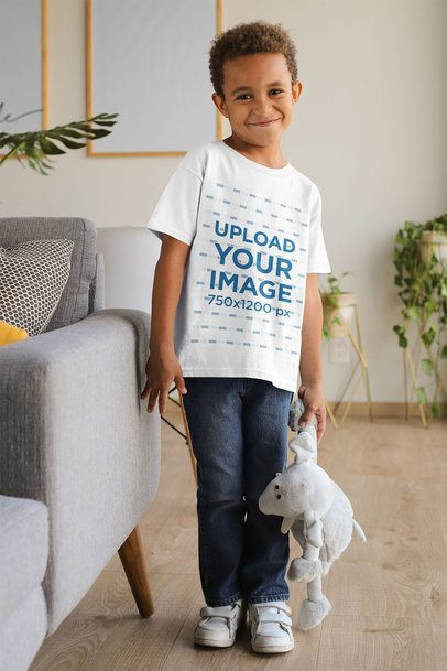 T-Shirt Mockup of a Boy with a Coy Smile Holding a Cuddly Toy 31637