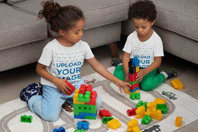 T-Shirt Mockup Featuring Two Siblings Playing with Blocks 32154