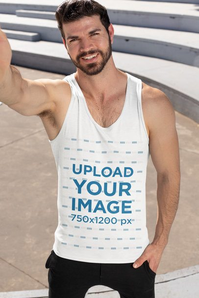 Tank Top Mockup Featuring a Man Taking a Selfie on the Street 32545
