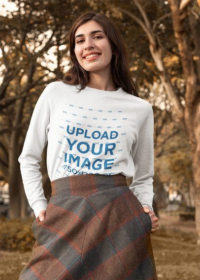 Crewneck Sweatshirt Mockup Featuring a Happy Woman Posing in the Park 31809