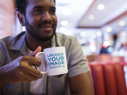 Mug Mockup of a Young Man at a Diner a12320