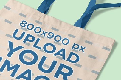 Mockup of a Tote Bag Placed on a Customizable Surface 3116-el1