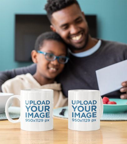 Mockup of Two Mugs Placed in Front of a Dad and His Son 33114