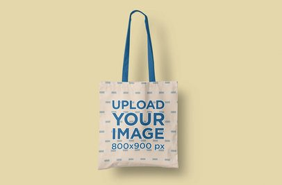 Mockup of a Customizable Tote Bag Placed Over a Plain Color Backdrop 3118-el1