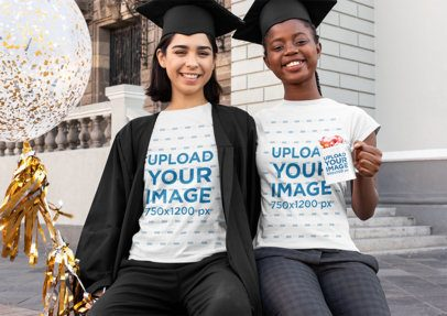 Mockup of Two Female Friends Wearing T-Shirts and Holding a Mug on Graduation Day 32574