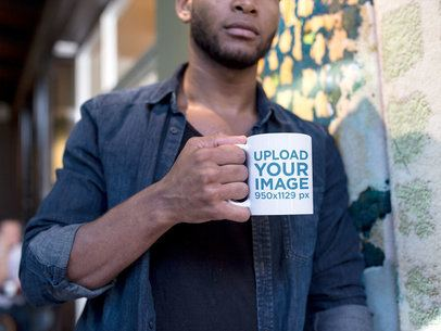 Young Black Man Holding a Mug Mockup a12293