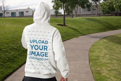 Hoodie Mockup of a Man Jogging at a Park 32314