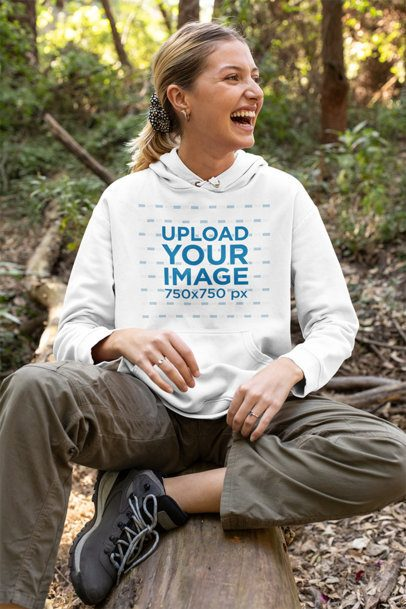 Mockup Featuring a Happy Woman with a Pullover Hoodie in the Woods 32219