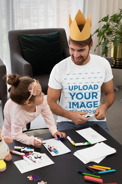 T-Shirt Mockup Featuring a Man Drawing With His Daughter at Home 33068