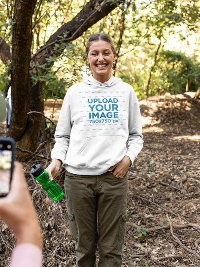 Mockup of a Smiling Woman Wearing a Hoodie in Nature 32221