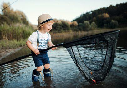 T-Shirt Mockup Featuring a Boy Holding a Fishing Net 3234-el1