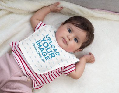 Baby Bib Mockup Featuring a Baby Girl Lying Down 32458