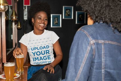 T-Shirt Mockup of a Woman Talking to a Friend at a Bar 32313
