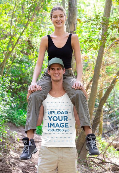 Tank Top Mockup Featuring a Woman Sitting on a Man's Shoulders After a Hike 32228