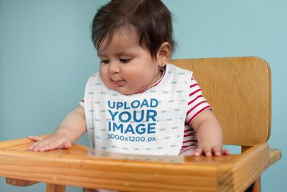 Bib Mockup Featuring a Baby in a High Chair 32463