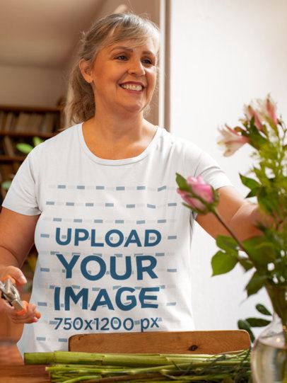 T-Shirt Mockup of a Happy Woman Fixing Up a Flower Vase 32203