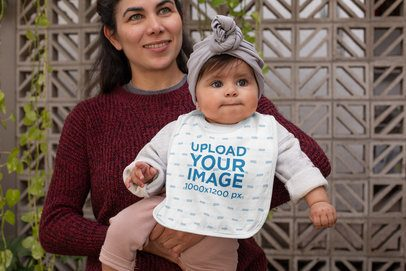 Bib Mockup of a Mom Holding Her Baby 32480