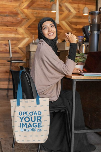 Tote Bag Mockup of a Woman in a Hijab at a Cafe 32399