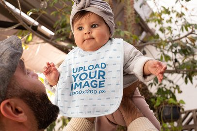 Bib Mockup Featuring a Baby Being Held by Her Dad 32481