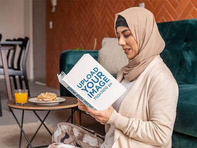 Book Mockup of a Woman with a Hijab Reading at Home 32404