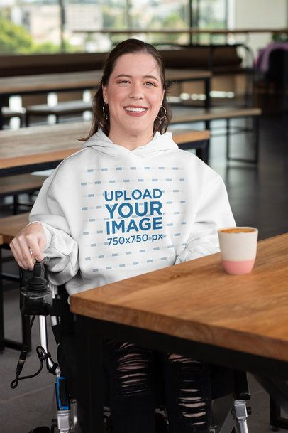 Mockup Featuring a Happy Woman with a Pullover Hoodie at a Restaurant 32524