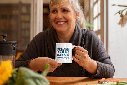 Mockup of a Woman Drinking From an 11 oz Mug at Home 32206