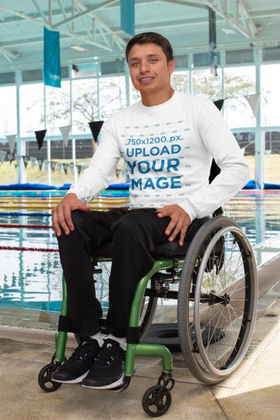 Long Sleeve Tee Mockup of a Man Using a Wheelchair Posing by a Pool 32489