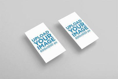 Mockup of Two Embossed Vertical Business Cards Over a Colored Surface 33657