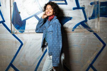 Mockup of a Young Woman Wearing a Denim Jacket at an Urban Setting 32565