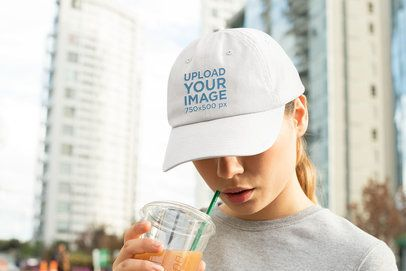 Dad Hat Mockup of a Woman with a Beverage 32456