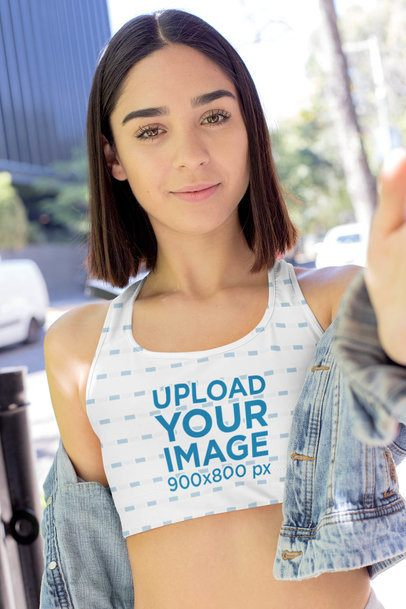 Sports Bra Mockup Featuring a Woman with Short Hair Taking a Selfie 32479