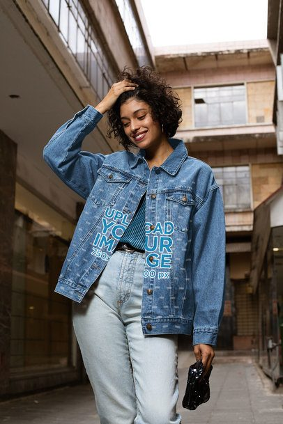 Denim Jacket Mockup Featuring a Smiling Woman Holding Her Hair 32569