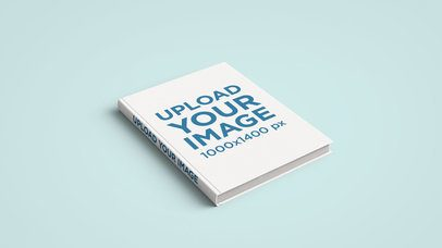 Minimal Mockup Featuring a Hardcover Book Lying Over a Plain Color Surface 2427-el1