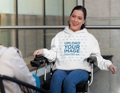 Hoodie Mockup of a Happy Woman Using a Wheelchair while Talking to Someone 32540