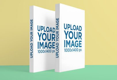 Mockup of Two Hardcover Books Standing Against a Flat Background 3404-el1